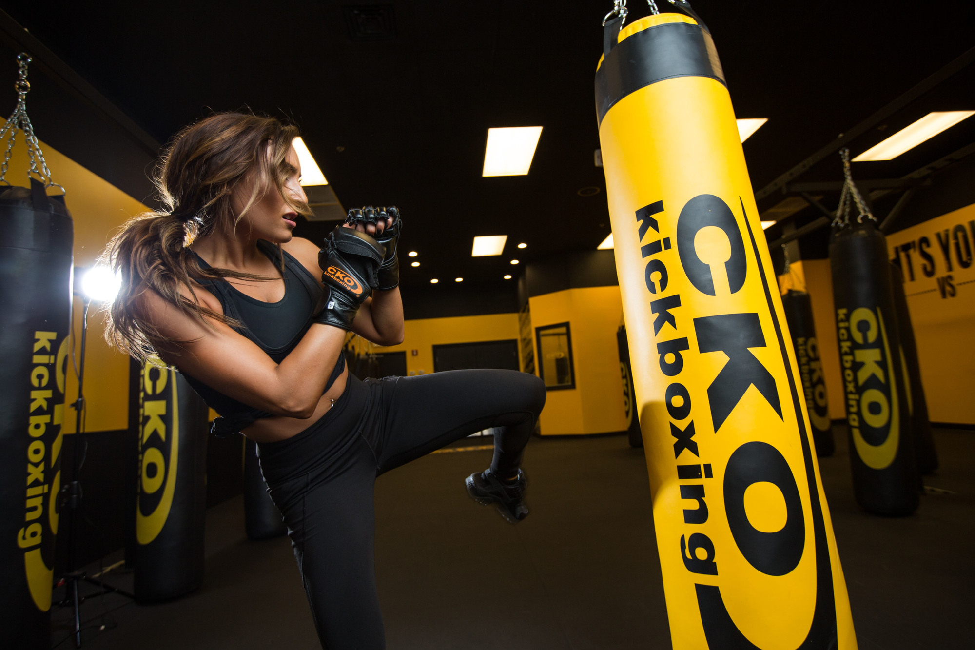 Trainer high kick on punching bag.