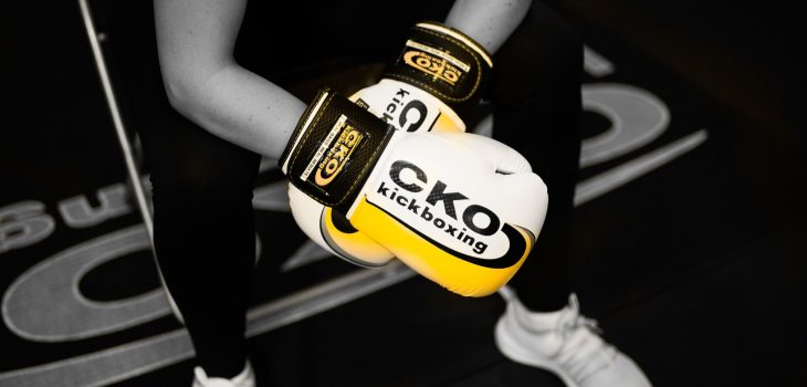 Female boxer with white CKO boxing gloves