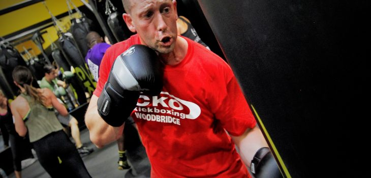 Male in red cko shirt boxing